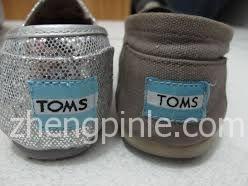 真假TOMS鞋后跟的对比